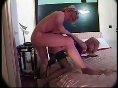 Hot blonde tranny wearing black stockings sucks a big dick and gets fucked
