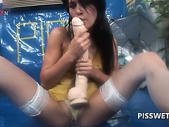 Gagging tramp pissing with a dildo in her wet lusty cunt